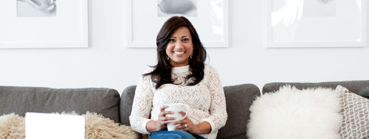 Kavita sitting on a couch